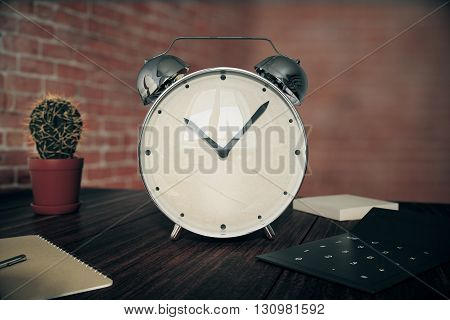 Glossy alarm clock on wooden desk with cactus calculator and other items on red brick wall background. 3D Rendering