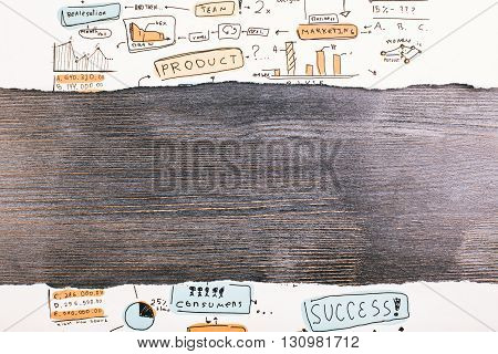 Ripped business sketch revealing dark wooden surface. Mock up