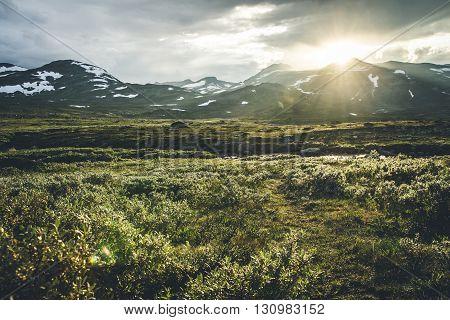 Sun setting over mountains Jotunheimen National Park Norway