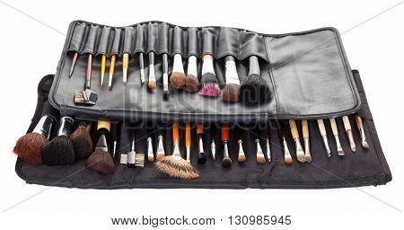 Two sets cosmetic brushes in black covers isolated on white background.