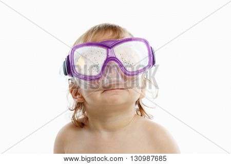 Baby diver in swimming mask with a happy face close-up portrait, on white background.