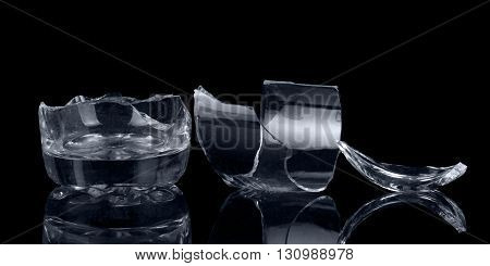 Fragments of glass container isolated on a black background.