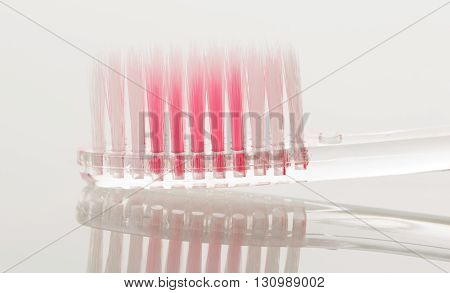 New toothbrush close-up isolated on white background.