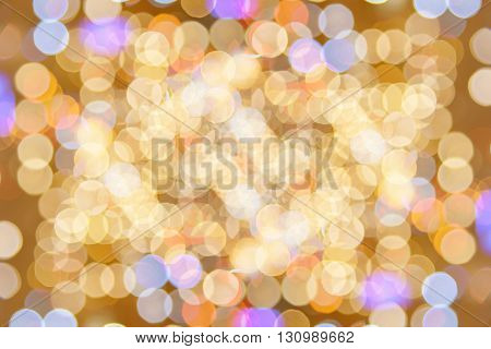 Colorfull bokeh glitter defocused lights abstract background.