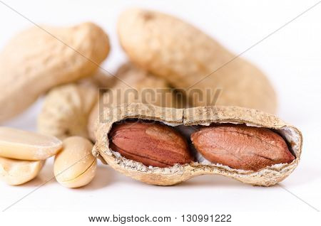 Peanuts on a white background. Isolated. Building from nuts. Balance. Open shell. Nutrition. Peanuts butter.