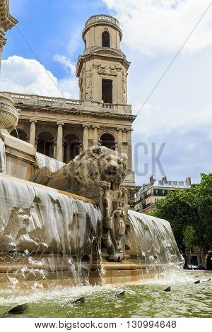 Paris, France - May 14: This is fragment of the fountain and the tower of the church of Saint-Sulpice May 14 2013 in Paris, France.