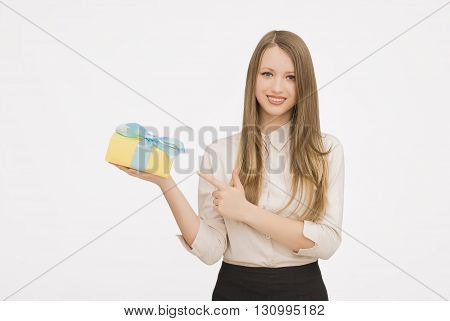 Young woman portrait presenting gift on isolated background
