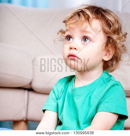 Sad Little Boy Sitting