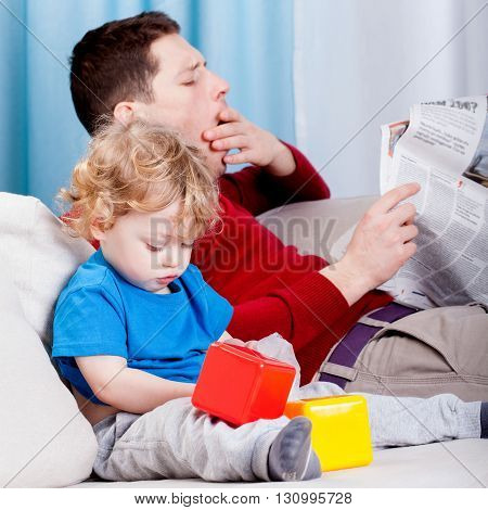 Bored Dad Reads The Newspaper