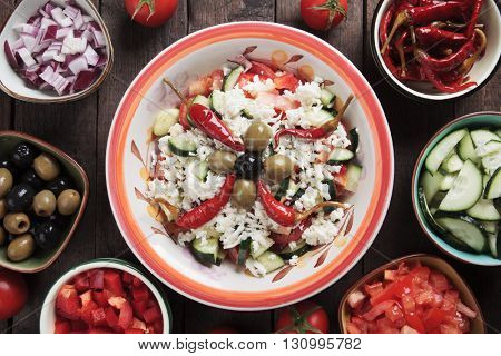 Shopska salad with cheese, tomato, cucumber, onion, olives and chili peppers