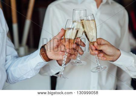 Three Successful Businessman Toasting Champagne