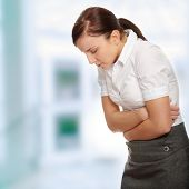 stock photo of young women  - Business woman with stomach issues - JPG