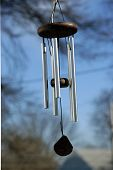 stock photo of windchime  - a wind chime isolated against a bright blue sky - JPG