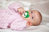 pic of babygro  - 5 months baby girl laying on white sheet - JPG