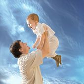 stock photo of 35 to 40 year olds  - Father is lifting 2 years old baby boy - JPG