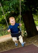 Two years old baby boy swinging.