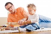 image of happy baby boy  - Father and two year old child playing together with wooden toy train - JPG