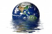 stock photo of global-warming  - the earth melting into a puddle showing the possible effects of global warming - JPG