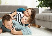 picture of happy family  - Happy family playing at home - JPG