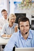 stock photo of business-office  - Young customer service operators working in office - JPG