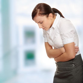 pic of beautiful young woman  - Business woman with stomach issues - JPG