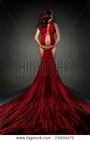 Sexy Woman In Red Waving Dress Looking Down.