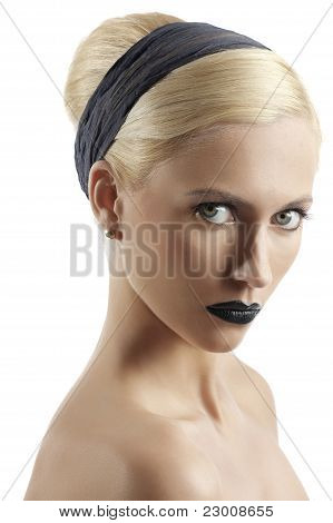 Fashion Shot Of Blond Girl With Hair Style Looking At The Camera