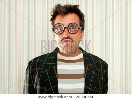 nerd silly myopic man with glasses doing funny expression with retro mustache