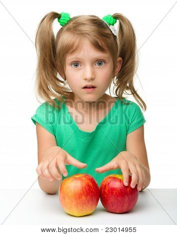 Portrait Of A Little Girl With Apple
