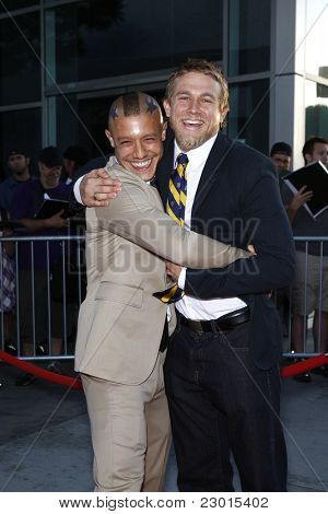 LOS ANGELES, CA - AUGUST 30: Charlie Hunnam; Theo Rossi at the FX's 'Sons Of Anarchy' season 4 premiere at the ArcLight Cinemas Cinerama Dome on August 30, 2011 in Los Angeles, California