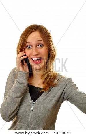 Surprised Woman Crying Out On Mobile Phone On A White Background