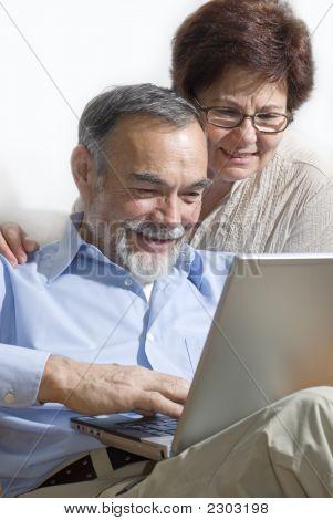 Senior Couple On Laptop