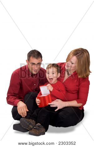 Father And Pregnant Mother Giving Son A Gift