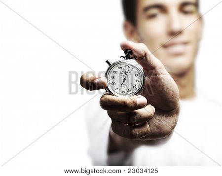 portrait of young man holding a vintage timer against a white background