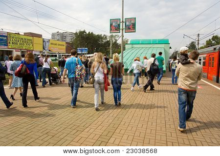 people on railway station go to the International Aviation and Space salon MAKS