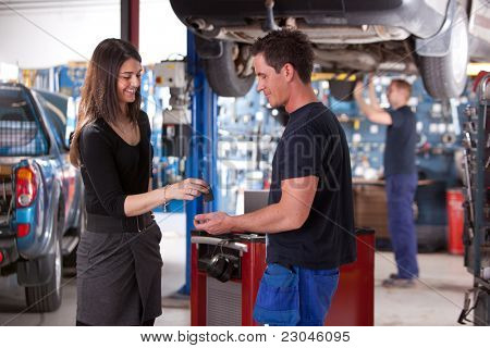 A happy customer delivering a car to a auto repair shop