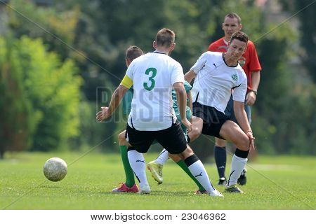 KAPOSVAR, HUNGARY - AUGUST 27: Roland Krasznai (white 3) in action at the Hungarian National Championship under 18 game between Kaposvar (green) and Gyor (white) August 27, 2011 in Kaposvar, Hungary.