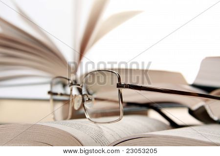 Spectacles On Book