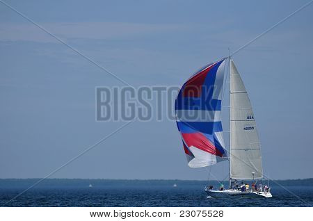 Sailboat With Colorful Spinaker Sail Sailing On A Summer Day