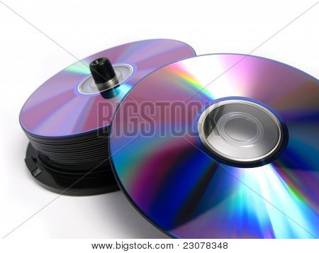 Stack of DVDs and CDs in a package