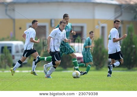 KAPOSVAR, HUNGARY - AUGUST 27: Unidentified players in action at the Hungarian National Championship under 18 game between Kaposvar (green) and Gyor (white) August 27, 2011 in Kaposvar, Hungary.