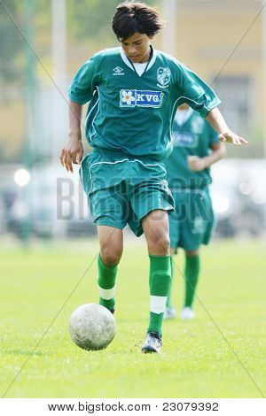 KAPOSVAR, HUNGARY - AUGUST 27: Valentin Hadaro in action at the Hungarian National Championship under 18 game between Kaposvar (green) and Gyor (white) August 27, 2011 in Kaposvar, Hungary.
