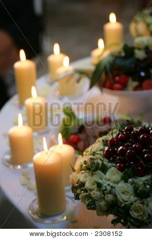 Candles Burning On Table At Reception