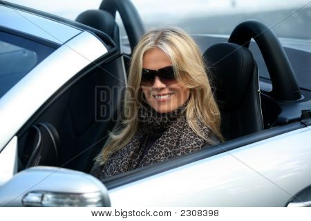 Blond Girl In A Car