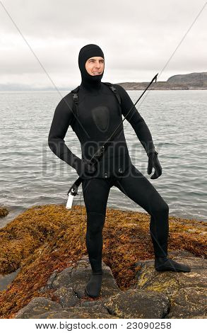 Freediver In A Diving Suit On The Barents Sea
