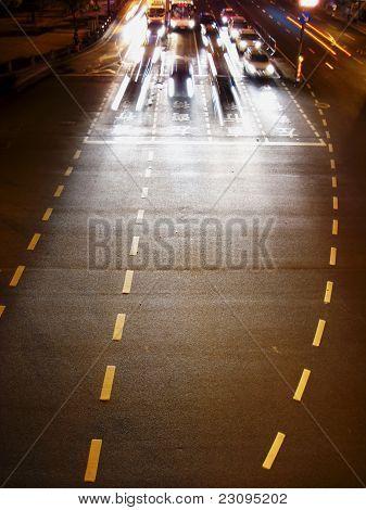 Cars At The Traffic Lights At Night