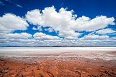 South Australia Outback desert with dry Salt Lake Eyre under cloudy sky as panorama  poster