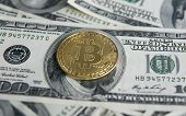 Golden Bitcoins On Us Dollars. Digital Currency Close-up. New Virtual Money. Crypto Currency Top Vie poster