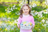 Child With Bunny Ears On Garden Easter Egg Hunt poster