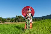 foto of hmong  - Portrait Hmong from Laos with parasol and traditional national costume - JPG